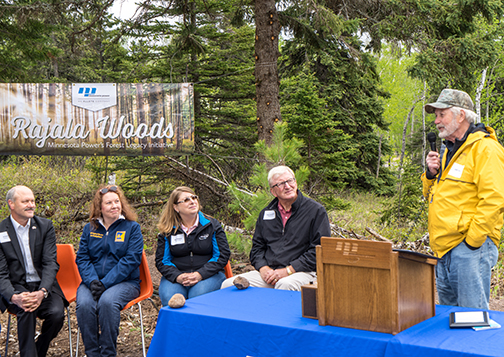 Al Hodnik, ALLETE CEO; Lori Dowling-Hanson, Minnesota DNR; Deb Amberg, ALLETE senior vice president, general counsel and secretary; and Jack Hedstrom of Hedstrom Lumber listen as Jack Rajala speaks about the importance of white pines and other conifer trees.