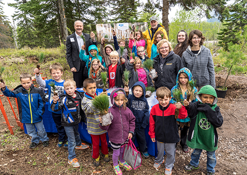 Birch Grove students show they're ready to plant white pine seedlings.